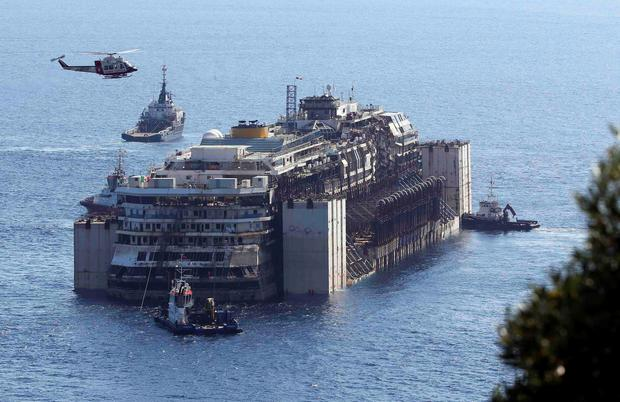 Tugboats push cruise liner Costa Concordia anticlockwise during its refloat operation maneuvers at Giglio Island