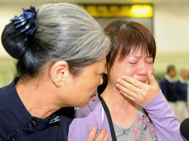 A relative of a passenger on board the crashed TransAsia Airways plane cries in Kaohsiung International Airport, southern Taiwan, July 23, 2014