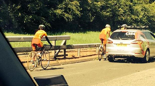 Handout photo taken from the twitter feed @jonny_brownlee with permission of members of Sri Lanka's Commonwealth Games team as they cycle down the M74 motorway near the exit for Motherwell and Hamilton in Scotland