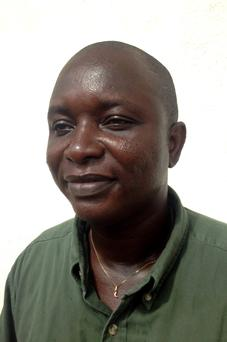 Sheik Umar Khan, head doctor fighting the deadly tropical virus Ebola in Sierra Leone, poses for a picture in Freetown, June 25, 2014