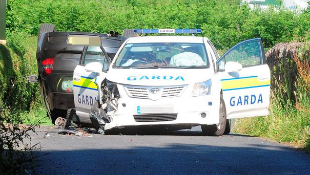 The scene at Little Pallas, about two miles outside Portlaoise, Co Laois, where a car rammed a patrol car. Photograph: James Flynn/APX