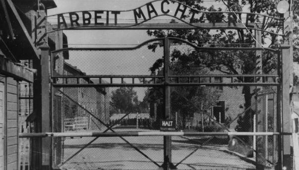 The main gate of Auschwitz, where Johann Breyer is said to have helped kill 216,000 Jewish men, women and children during the Second World War (AP)