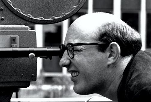 Louis Lentin looks through the viewfinder of a 16mm film camera while directing RTE series 'Kino' 1963. Pic courtesy of RTE.
