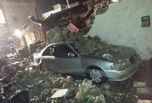 A car is seen covered in rubble from the wreckage of TransAsia Airways flight GE222 on Taiwan's offshore island of Penghu. A TransAsia Airways turboprop ATR-72 plane crashed on its second attempt at landing during a thunderstorm on Penghu, an island off Taiwan on Wednesday, killing 47 people and setting buildings on fire, officials said.