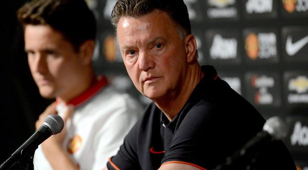 Louis Van Gaal says he wants Manchester United to find a fair balance between his management of the squad and the club's commercial activities. Photo: Jayne Kamin-Oncea-USA TODAY Sports