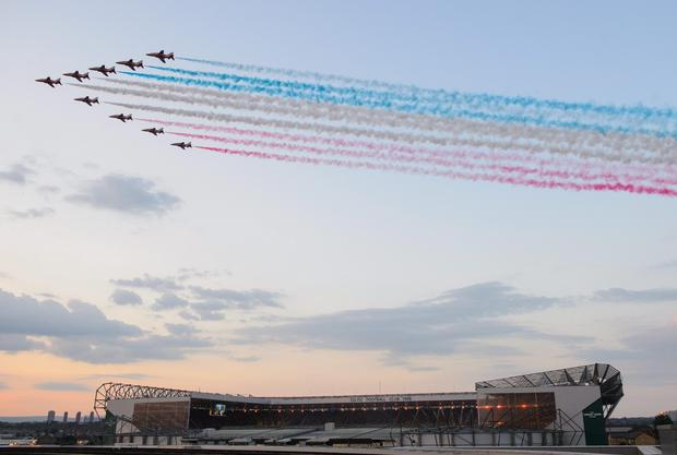 The Red Arrows fly over Celtic Park, during the 2014 Commonwealth Games Opening Ceremony, as seen from the Sir Chris Hoy Velodrome roof, in Glasgow. Dominic Lipinski/PA Wire.
