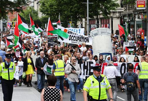 People take part in a protest march through Dublin city centre in in solidarity with the people of Palestine. Photo credit: Brian Lawless/PA Wire