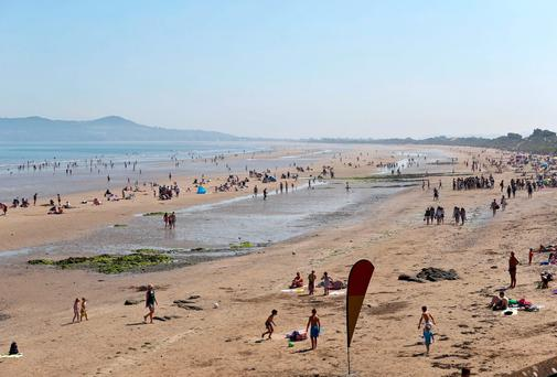 23/07/14 enjoying the soaring temperatures at Portmarnock Beach, Dublin this afternoon.... Picture Colin Keegan, Collins Dublin.