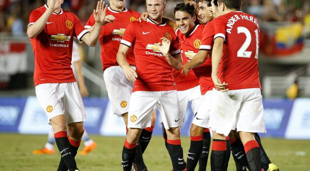 Manchester United players celebrate with Reece James (4th L) after he scored against the Los Angeles Galaxy during the second half of their friendly match in California