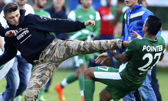 Maccabi Haifa's friendly stopped early after protesters attacked the Israeli team