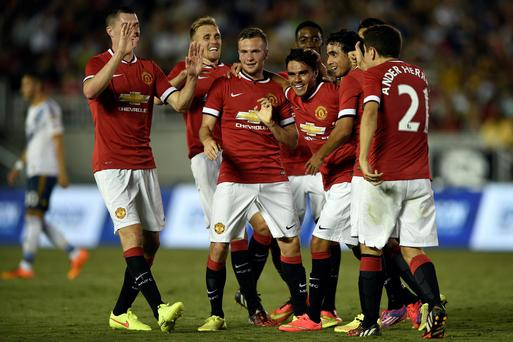 Manchester United 's first pre-season match offered clues to Louis Van Gaal's preferred stating XI for the new season