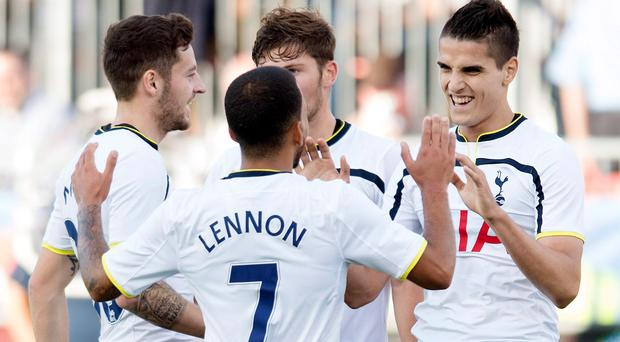 Tottenham Hotspur's Erik Lamela, right, celebrates his first goal of a friendly soccer game with teammates, from left to right, Ryan Mason, Aaron Lennon and Ben Davies during the first half against Toronto FC in Toronto last night
