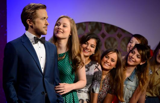 Visitors form a line to see the wax figure of Canadian actor Ryan Gosling, unveiled at Madame Tussauds, London, Wednesday, July. 23, 2014. (Photo by Jonathan Short/Invision/AP)