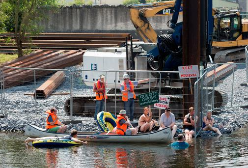 Protesters pictured where they stopped a pile driver from continuing work on the construction of the new bridge over the river note in Kilkenny. Picture: Dylan Vaughan