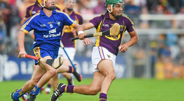 Keith Rossiter, Wexford, in action against Colm Galvin, Clare