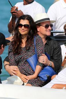 SAINT-TROPEZ, FRANCE - JULY 24: Bono and his wife Alison Hewson sighting at 'club 55' on July 24, 2014 in Saint-Tropez, France. (Photo by Pierre Suu/GC Images)