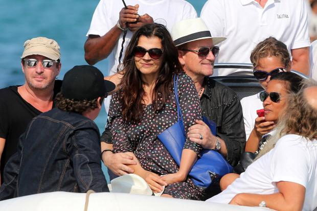 Bono and his wife Alison Hewson sighting at 'club 55' on July 24, 2014 in Saint-Tropez, France. (Photo by Pierre Suu/GC Images)