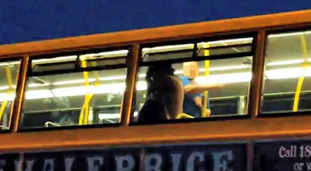 The man strikes the woman on a bus last night