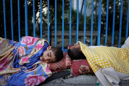 Palestinians taking refuge from an Israeli ground invasion and air strikes sleep at a United Nations school in Jabaliya in the northern Gaza Strip. Reuters/Finbarr O'Reilly