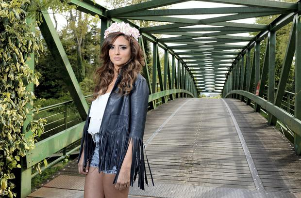 Nadia wears a vest and navy leather jacket by Kate Moss x Topshop; shorts at River Island; Flower crown is stylist's own