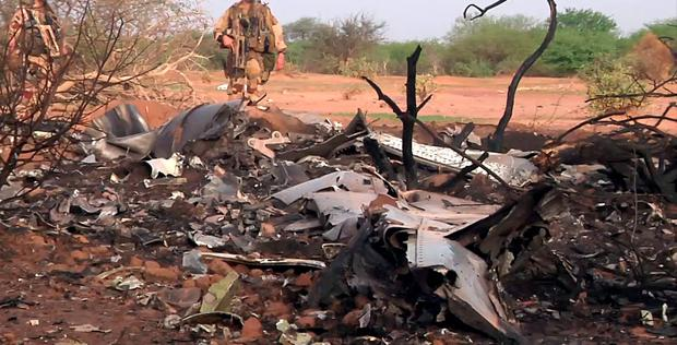 This photo provided Friday July 25, 2014 by the French army shows soldiers at the site of the plane crash in Mali. (AP Photo/ECPAD)