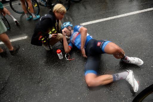 A doctor tends to New Zealand's Jack Bauer after he crashed in the last three kilometers of the nineteenth stage of the Tour de France