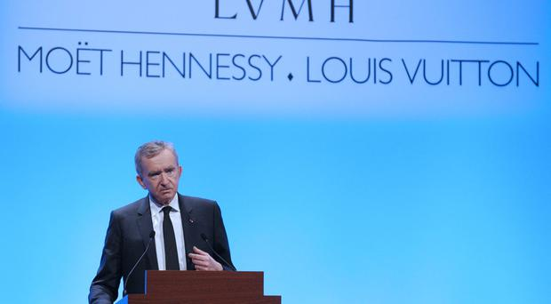 The chief executive officer of the world's biggest luxury goods maker LVMH, Bernard Arnault, presents the group's 2012 annual results on January 31, 2013 at company headquarters in Paris to . AFP PHOTO / ERIC PIERMONT (Photo credit should read ERIC PIERMONT/AFP/Getty Images)