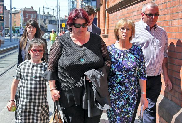 John (right) and Kathleen (wearing black) Conroy, their daughter, Sorcha (6) and Brigid Doherty, Patient Advocate with Patient Focus , second from right pictured leaving Dublin City Coroners Court this afternoon after the inquest into the death of their six year old daughter, Aibha Conroy who died in Temple Street Children's Hospital in December 2011.