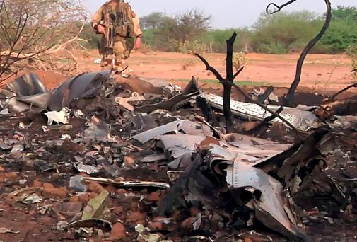 A French soldier at the site of the plane crash in northern Mali