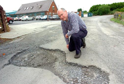 Frank Towmey MD TMC Meats Dromone Co Meath with one of the potholes. Picture: Seamus Farrelly