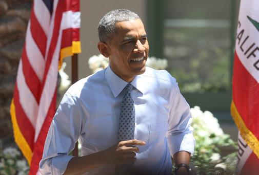 US President Barack Obama arrives to the stage to deliver remarks on the economy at Los Angeles Trade-Technical College on July 24, 2014 in Los Angeles, California.