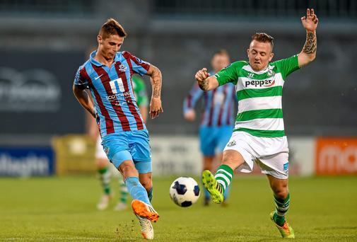 Gavan Holohan, Drogheda United, in action against Gary McCabe, Shamrock Rovers