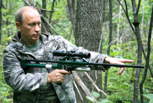 Russia's Prime Minister Vladimir Putin holds a tranquilliser gun as he visits the academy of sciencies Ussuri reserve in Russia's Far East in 2008
