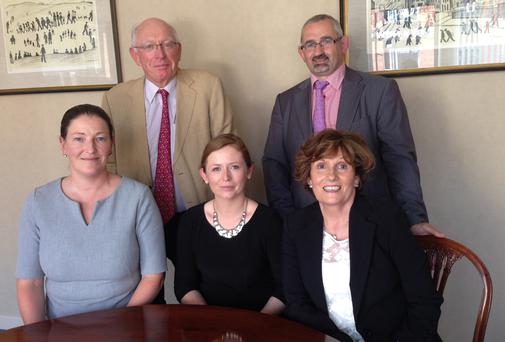 THE TEAM: Ruth Cody, Lucy Connolly, Maureen Cooney; Edward Lyons and Paul Kelly (back row)
