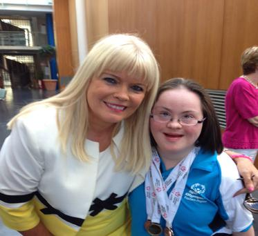 Mary Mitchell O'Connor hugs Ciara Lynch after she receives three Special Olympics medals
