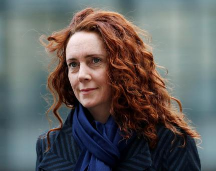 Former News International chief executive Rebekah Brooks arrives at the Old Bailey courthouse in London in this February 28, 2014 file photo. To match Special Report BRITAIN-HACKING/BROOKS REUTERS/Suzanne Plunkett/Files (BRITAIN - Tags: CRIME LAW MEDIA POLITICS)