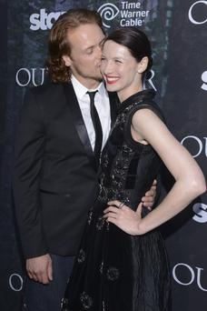 Actor Sam Heughan and actress Caitriona Balfe attend the Starz Series