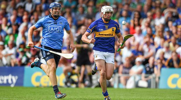 Patrick Maher, Tipperary, in action against Conal Keaney, Dublin. GAA Hurling All Ireland Senior Championship Quarter-Final, Tipperary v Dublin. Semple Stadium, Thurles, Co. Tipperary. Picture credit: Diarmuid Greene / SPORTSFILE