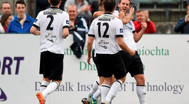 Kurtis Byrne, right, Dundalk, is congratulated by team-mates after scoring his side's second goal