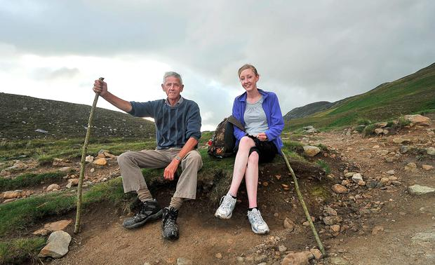 Early Climbers: father and daughter Charlie and Catriona Norris from Moate, Co Westmeath on their way to the summit of Croagh Patrick. Photo: Conor McKeown