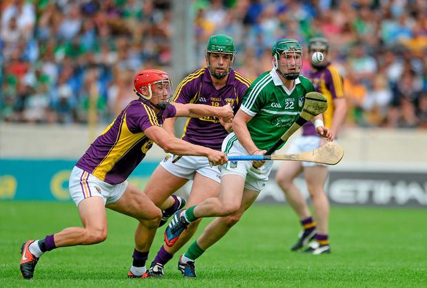 Limerick's Thomas Ryan in action against Wexford pair Lee Chin (left) and Richie Kehoe during the quarter-final clash in Thurles. Photo: Dáire Brennan / SPORTSFILE