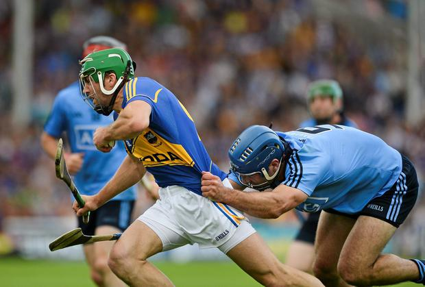 Dublin's Stephen Hiney grabs the jersey of James Woodlock of Tipperary during the quarter-final clash in Semple Stadium. Photo: Dáire Brennan / SPORTSFILE