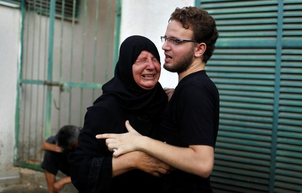 The mother of a Palestinian child reacts following his death at a hospital in Gaza City - ***WARNING - GRAPHIC IMAGES IN GALLERY***