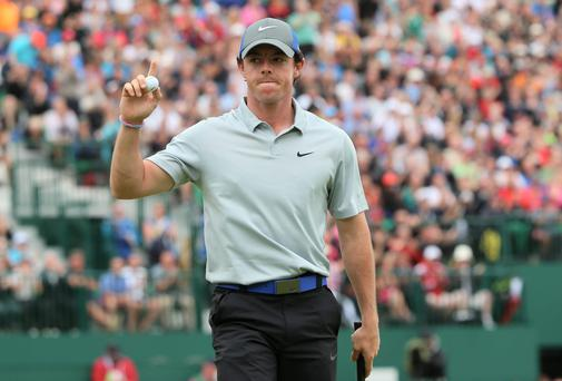 Rory McIlroy waves to the gallery on the 18th green after his third round at the Open Championship at Royal Liverpool. Photo: Andrew Redington/Getty Images