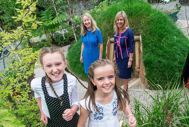 Dee Ahearn, Chief Executive of Barrettstown and Siobhan Talbot, Group Managing Director Glanbia Plc with Sinead Ni Raghallaigh (11) and Keva Murtagh (9). Photo: Pat Moore.