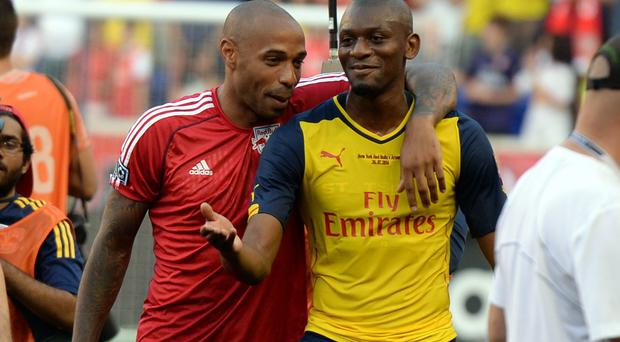 Arsenal midfielder Abou Diaby (left) - pictured with former teammate Thierry Henry after the friendly match between Arsenal and the New York Red Bulls last summer