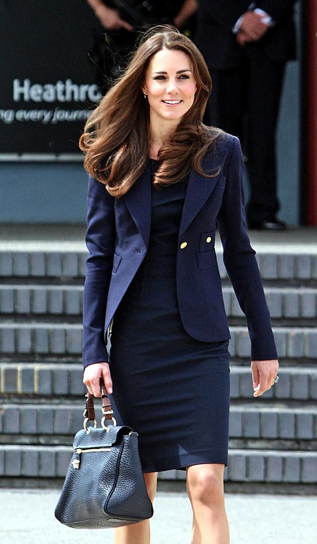 Catherine, Duchess of Cambridge arrives to board a plane of the Royal Canadian Air Force at London's Heathrow Airport on June 30, 2011