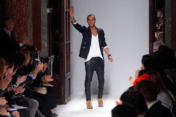 French fashion designer Olivier Rousteing for Balmain acknowledges the public at the end of his Spring/Summer 2013 ready-to-wear collection show on September 27, 2012 in Paris. AFP PHOTO/PIERRE VERDY