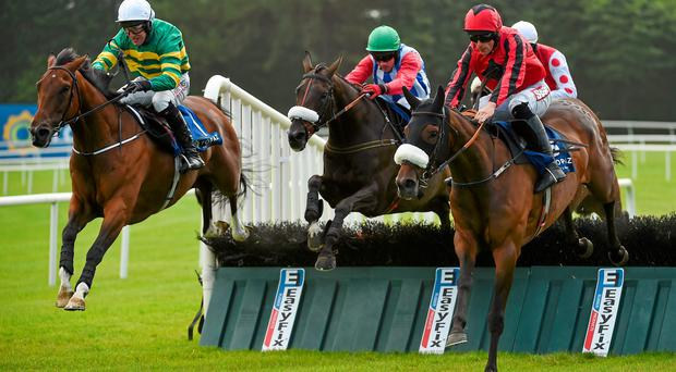 Shield (left) with Robbie Power up, jumps the last ahead of Here For The Craic (centre) and Davy Condon, and Queen Alphabet (Davy Russell, right), on their way to winning the Topaz Novice Hurdle at Galway. Photo: Barry Cregg / SPORTSFILE