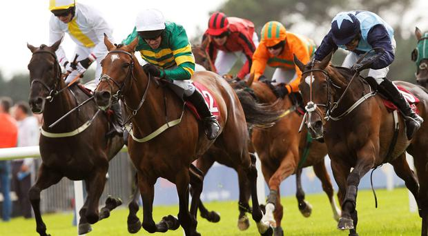 Barry Geraghty drives Jacksonslady (centre) to victory from runner-up Cailin Annamh (right) and Butney Boy (left) at Galway. Photo: Brian Lawless/PA Wire